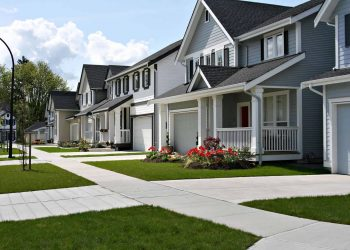 row of houses in the suburbs with grey and white paint theme