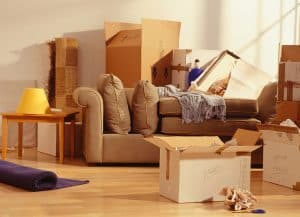 boxes and partially packed furniture in a house