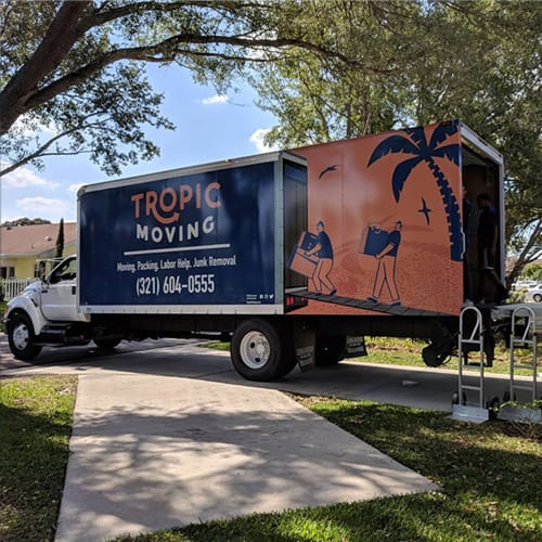 Tropic Moving Truck on a home driveway