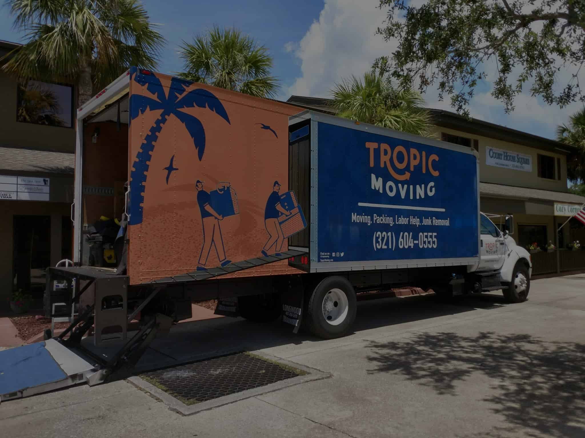 Tropic moving truck in front of office