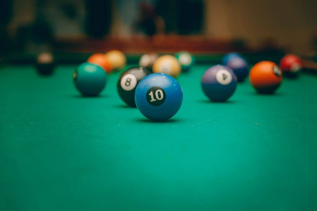billiard balls on a green felt table