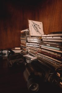 records and cd cases on dark wooden furniture