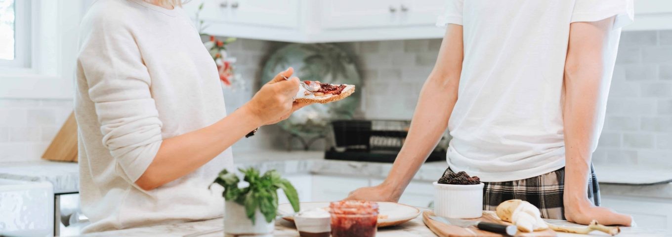 couple eating in kitchen